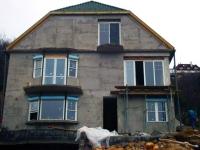 családi ház tolóablakokkal